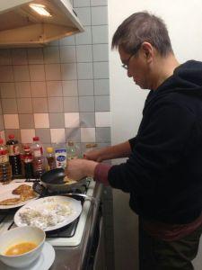 apprentice chef at work frying white radish cake